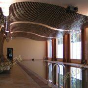 Радиусный деревянный реечный потолок в бассейне частного дома поселка Барвиха. Бренд Luxalon Люксалон